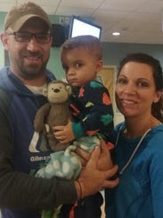 Cason Balsis with his parents at the hospital after