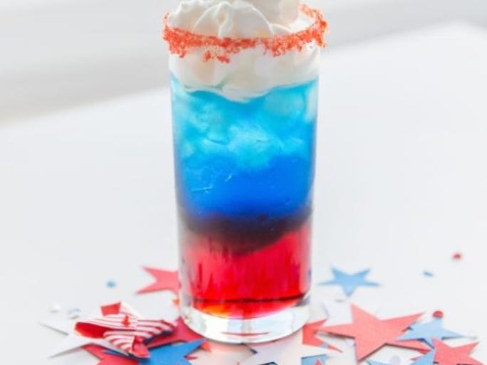 Rock & Reilly's is serving Fireworks, made with grenadine, heavy cream (or Bailey's Irish Cream) and blue curacao, at the top of Renaissance New York Midtown Hotel.  Rock & Reilly's
