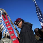 North Dakota pipeline protesters, including veterans, say they'll stay despite victory