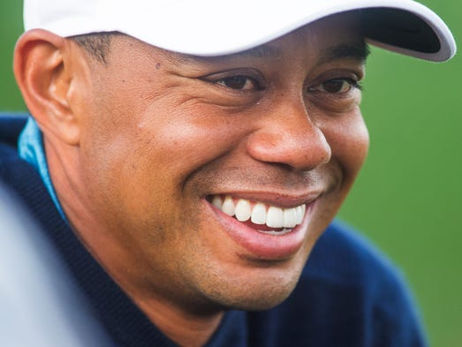Jan 27, 2015; Scottsdale, AZ, USA; -Tiger Woods smiles