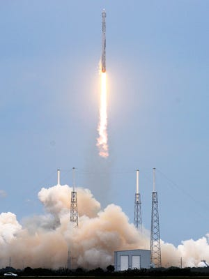 A SpaceX Falcon 9 rocket lifts off from Complex 40 at Cape Canaveral Air Force Station Friday, April 18, 2014.  The rocket is carrying supplies to the International Space Station.