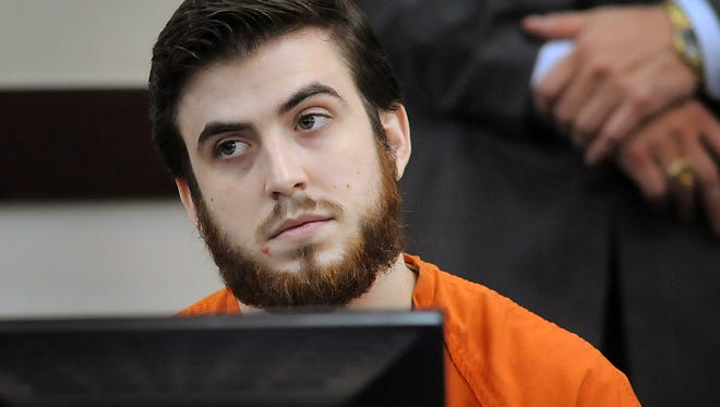 Jacob Hughes listens during his sentencing hearing Friday, Dec. 11, 2015, in Judge Mark Fishburn's courtroom. At the trial a couple of months ago, Hughes became agitated after the verdict was read, yelling out obscenities to the court. Hughes did not act out as the sentencing was released Friday.