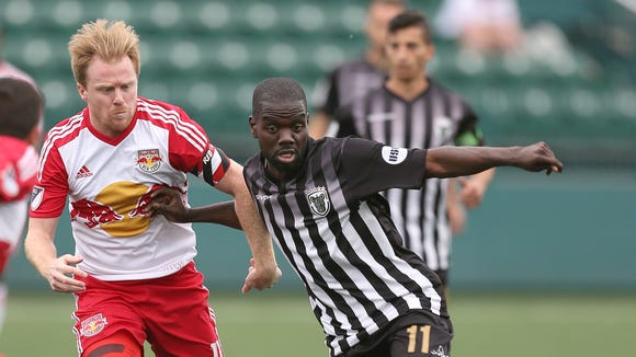 Rhinos midfielder Kenardo Forbes, right, was named team MVP last year and is one of 10 returning players.