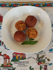 These Arancini, rice balls stuffed with mozzarella cheese and bolognese sauce, will be served when Zanelli's opens on Aug. 23.
