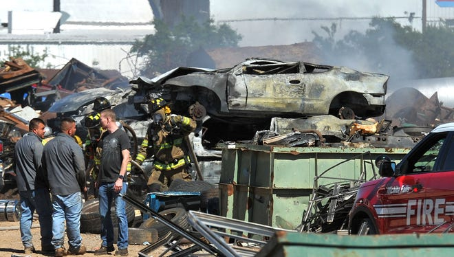 Smoke smolders from a pile of scrapped vehicles Wednesday afternoon at a scrap metal yard located in the 1900 block of Sheppard Access Road. A call came in shortly after 4 p.m. of a vehicle on fire. When firefighters arrived, they found the pile of scrapped vehicles on fire and black smoke billowing from the scrapyard. Multiple units from the Wichita Falls Fire Department were dispatched to the scene.
