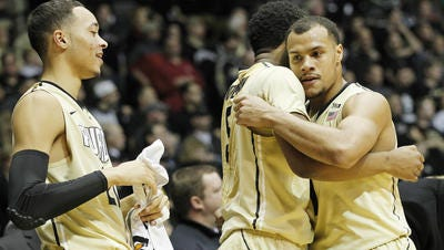 Bryson Scott (from right), Basil Smotherman and Kendall Stephens celebrate during Purdue's 83-67 win over Indiana at Mackey Arena on Jan. 28.