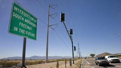 A city of Phoenix sign marks the proposed South Mountain Freeway extension at 24th Street & Pecos Road.