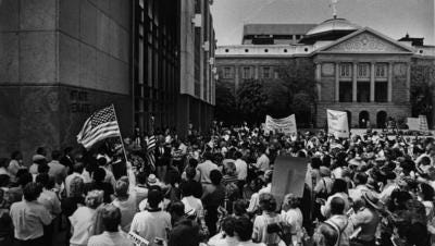 Arizonans for a Martin Luther King Jr. state holiday held a rally in front of the State Senate on April 24, 1989