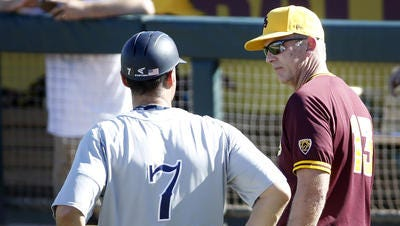 ASU baseball coach Tracy Smith, right, is concerned about his team showing a lack of confidence in a four-game losing streak.