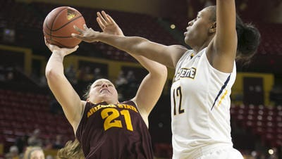 ASU's Sophie Brunner (21) and Marquette's Erika Davenport will duel again Saturday. The Sun Devils won last season 90-80.