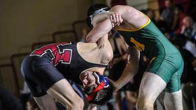 Montgomery's Liam Dwyer, right, applies pressure to Hillsborough's Christian Monyer during their 152-pound match in the East Brunswick Bear Invitational Wrestling Tournament at Churchill Jr. High School in East Brunswick on Dec. 28, 2016.