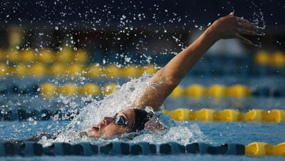 Katie Hoff won the 200-meter individual medley in her return to major swimming competition at the Arena Grand Prix in Mesa.
