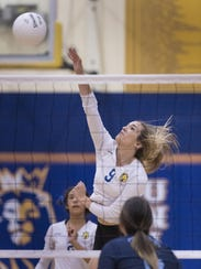 Exeter's Olivia Harden hits against Redwood in Central