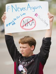 "James Lacy, 12, participates in the ""Parkland Memorial and Protest"" event at the Unitarian Universalist Church of Fort Myers, Florida."