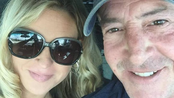 Kate Major and Michael Lohan pose for a Facebook selfie.