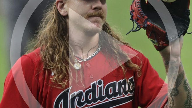 Cleveland Indians starting pitcher Mike Clevinger gets another ball after giving up a home run in the first inning in a baseball game, Wednesday, Aug. 26, 2020, in Cleveland.