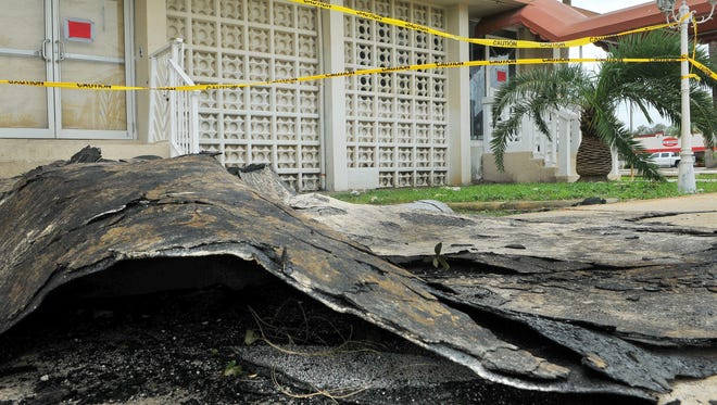 Pieces of roof were scattered in the parking lot of the Blue Beach Club apartments off U.S. 1 in Titusville, one of the more prominent locations of local damage from Hurricane Matthew.