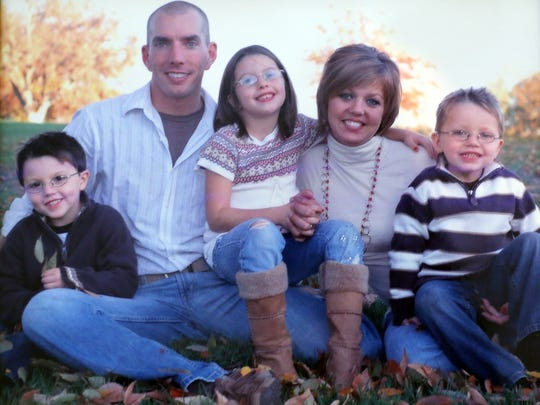 Dane Norem is photographed with his wife, Amanda, and three children shortly after he became a highway patrol officer.