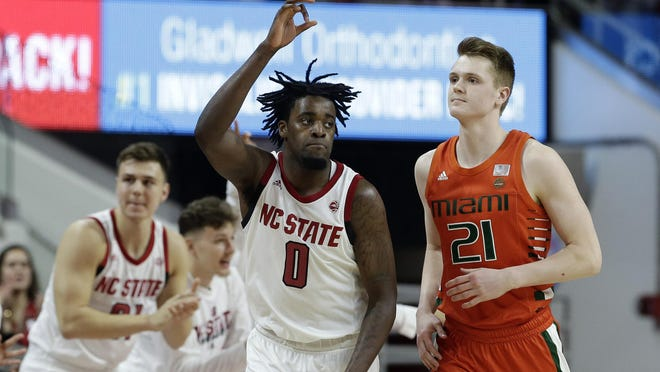 North Carolina State forward D.J. Funderburk (0) reacts following a basket while Miami forward Sam Waardenburg (21) looks on during the second half of an NCAA college basketball game in Raleigh, N.C., Wednesday, Jan. 15, 2020.
