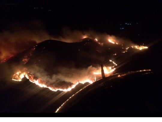 A 900-acre fire erupted west of Ventura, Calif., on
