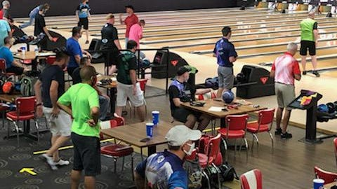 Players practice social distancing with no spectators permitted during Sunday's Furbay Electric Open at AMF Hall of Fame Lanes.
