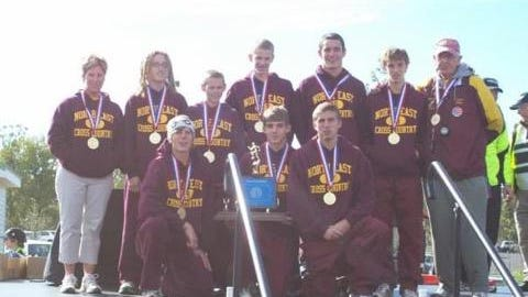 Members of the 2007 North East boys cross country team pose with head coach Halli Reid, far left, and assistant Ted Miller, far right, after winning the PIAA Class 2A team championship.