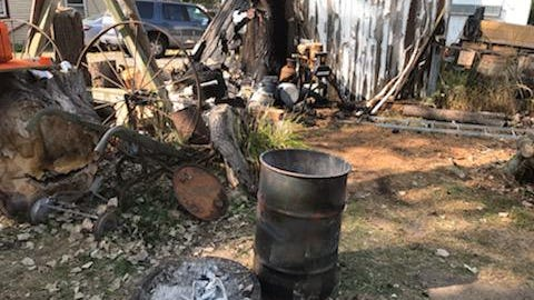A fire of unknown origin destroyed this outdoor craft workshop area at a home in Evergreen Acres in Monroe Township last week.