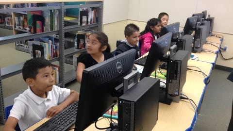 First-graders at Tiburcio Vasquez School in Salinas prepare for a lesson in the computer lab on Thursday.