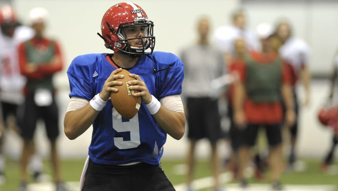 UL quarterback Brooks Haack (9) drops back for a pass during a training camp session at the Leon Moncla Indoor Practice Facility.