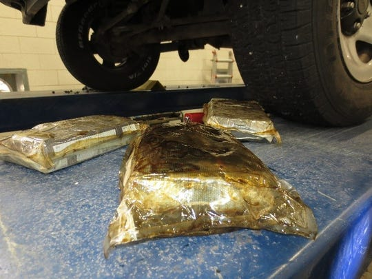 Cocaine packages were found hidden in the oil pan of a vehicle Sunday at the Santa Teresa border crossing.