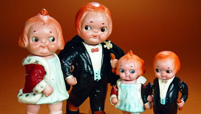 If these dolls look familiar, it's because they were restored by the artist who made similar children for Campbell Soup ads. The set sold for $6,880.