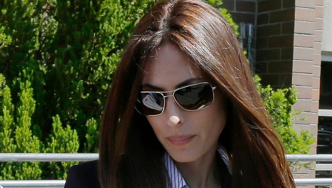 This May 30, 2014 file photo shows Kerri Kasem, the daughter of radio personality Casey Kasem, in Port Orchard, Wash. Iowa Gov. Terry Branstad signed a bill into law Friday, April 24, 2015, that tries to ensure adult children can see their ailing parents. One advocate for the bill is Kerri Kasem.