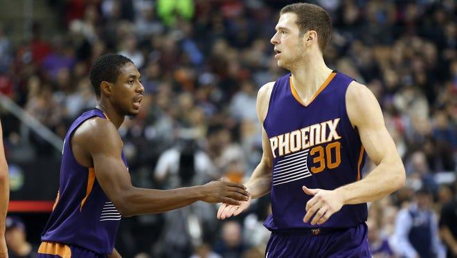 Nov. 29, 2015; Toronto, Ontario, Canada; Phoenix Suns forward Jon Leuer (30) is congratulated by point guard Brandon Knight (3) against the Toronto Raptors at Air Canada Centre.