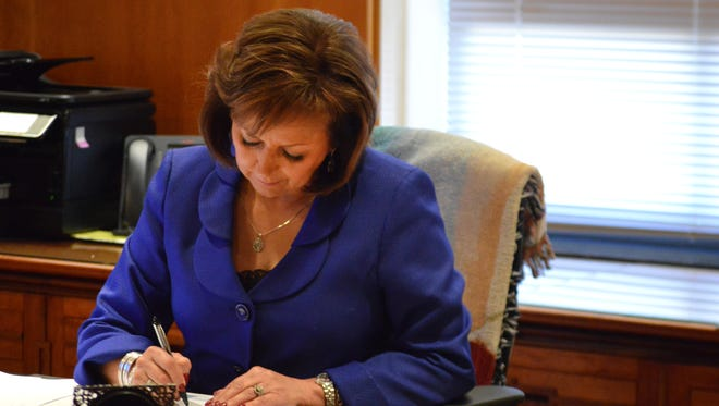 New Mexico Gov. Susana Martinez makes final edits to her State of the State speech in her office in Santa Fe on Jan 19.
