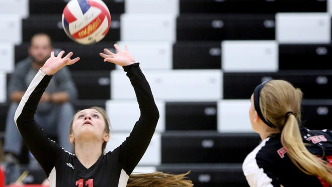 Pewaukee's Ally Longden set the ball against Messmer in WIAA Division 2 regional play at Pewaukee on Oct. 17.