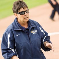 Ithaca Softball Coach Deb Pallozzi give instructions from third base during a May 2011 NCAA playoff game.