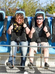 Merle Laswell/For the Register Johnston residents Erin Capps and Charlie Reese have fun on a ride Saturday during Oktoberfest at Adventureland. Johnston residents Erin Capps, 32, and Charlie Reese, 24, have fun on the tilt a wheel ride on Saturday, October 3, 2015, during Oktoberfest at Adventureland.