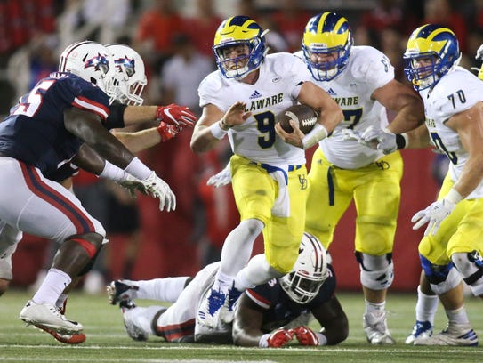 Delaware quarterback j. P. Caruso carries in the fourth