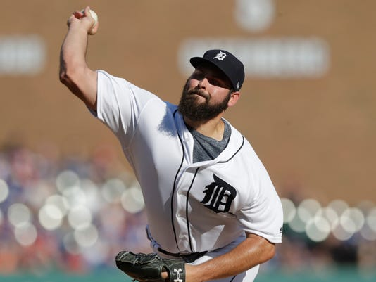 Detroit Tigers starting pitcher Michael Fulmer throws during the second inning of a baseball game against the Toronto Blue Jays, Saturday, July 15, 2017, in Detroit. (AP Photo/Carlos Osorio)