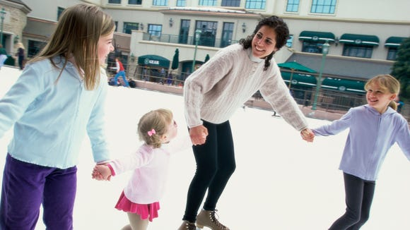 Take time to ice skate with your children for Christmas.