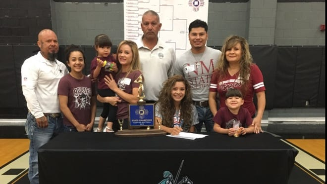 Oñate's Brandy Hernandez, bottom second from right, signed a National Letter of Intent to play softball for New Mexico State on Monday. Hernandez, an outfielder, was a All-District 3-6A selection for the 2016 Class 6A state champion Knights and will be on the South All-Star Team for the Class 5A/6A All-Star Game as well.