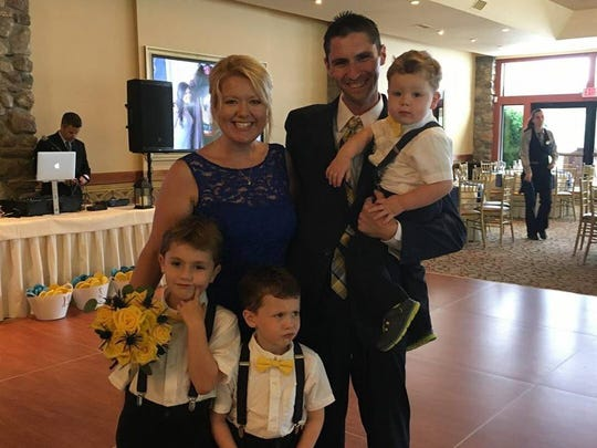 Christie Baglio of Henrietta poses in 2017 with her husband, Nick, and sons Brycen, 8, Trevor, 5, and Carter, 2.