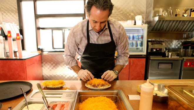 Roger David, the new CEO of Gold Star Chili makes a 3- way at the Mt. Washington location. David's father and uncles founded the restaurant in 1965 in Mt. Washington. The company has grown to 89 locations with locations in Ohio, Kentucky and Indiana.