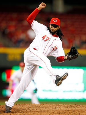 Cincinnati Reds starting pitcher Johnny Cueto (47) pitches during the third inning against the Milwaukee Brewers at Great American Ball Park.