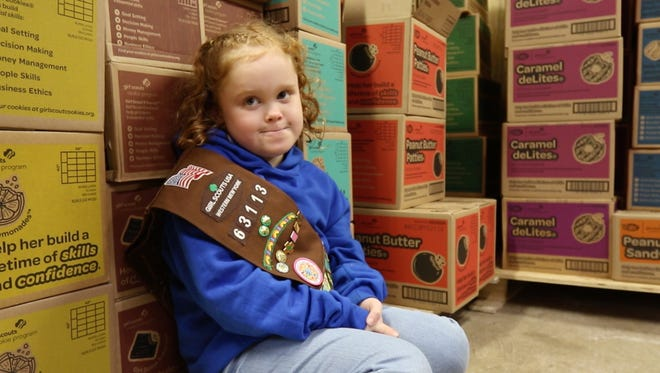 Kari Shaw, next to all the cookies she has sold, also sold over a thousand last year.