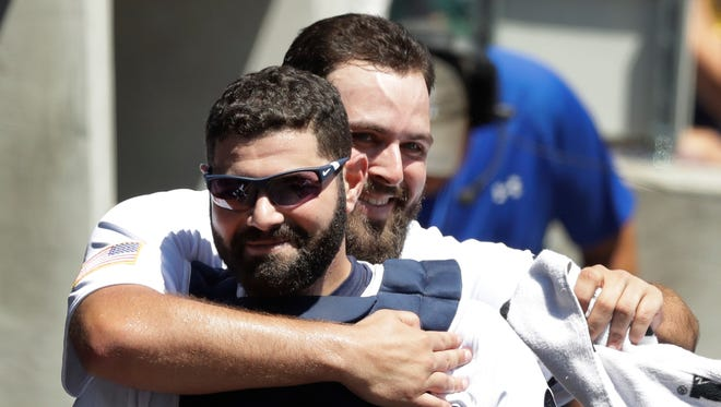 Tigers starting pitcher Michael Fulmer hugs catcher Alex Avila after completing the eighth inning against the Giants on July 4, 2017 in Detroit.