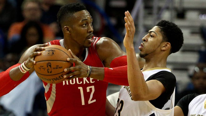 Houston Rockets center Dwight Howard is defended by New Orleans Pelicans forward Anthony Davis at the Smoothie King Center.