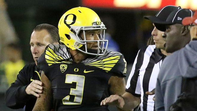 Oregon Ducks quarterback Vernon Adams (3) leaves the game after getting hit after the play was over during their game with Eastern Washington on Sept. 5, 2015, in Eugene, Ore.