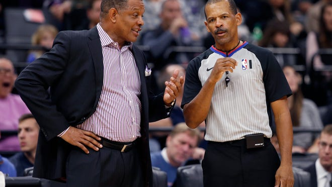 In this Jan. 4, 2020, fie photo, New Orleans Pelicans head coach Alvin Gentry, left, talks with referee Eric Lewis during the second half of an NBA basketball game in Sacramento, Calif. NBA players have been back on the court for a few weeks, some of that time being individual workouts before practices could resume when the 22 teams arrived at the Walt Disney World bubble. NBA referees haven't had that chance. There's a healthy amount of nervous anxiety for those who operate the whistles at NBA games right now, with exhibition games set to begin next week.