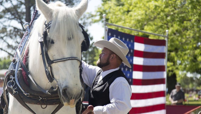 Troy Hall and his horse, Jill, show off Colorado Carriage and Wagon's patriotic buggy during the Memorial Day ceremony at Resthaven Funeral Home and Memorial Gardens Cemetery on Monday, May 30, 2016.